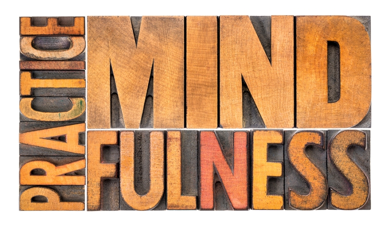 Practice mindfulness - isolated word abstract in vintage letterp